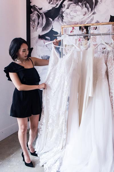 Angela Kim with a few of her couture wedding dresses