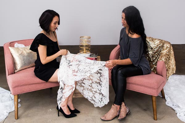 Angela Kim selecting fabrics for a custom wedding dress