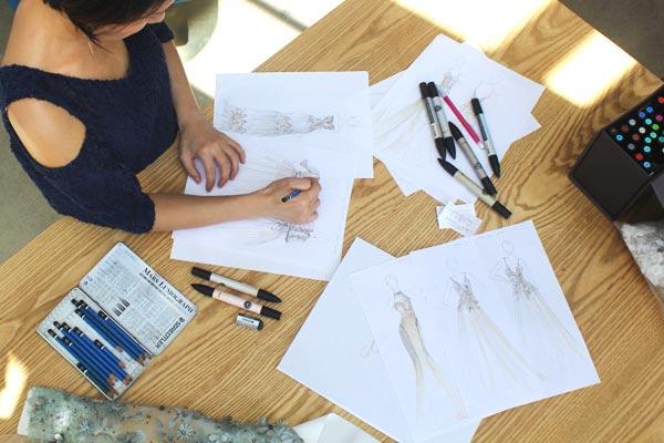 Angela Kim designing a custom wedding dress
